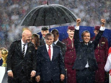 Vladimir Putin umbrella (Shaun Botterill / Getty)