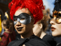 STRATFORD-UPON-AVON, ENGLAND - APRIL 23: Women dressed in mask take part in the Shakespeare Birthday Celebration Parade on April 23, 2016 in Stratford-upon-Avon, England. This year the traditional annual parade through the streets of Stratford-upon-Avon marks the 400th anniversary of Shakespeare's death. (Photo by Tristan Fewings/Getty Images)