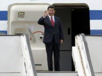 Chinese President Xi Jinping alights from the plane upon arrival in Caracas on July 20, 2014. Xi departed Argentina Sunday for Venezuela, the next-to-last stop of a Latin American tour aimed at bolstering trade with the region. AFP PHOTO/LEO RAMIREZ (Photo credit should read LEO RAMIREZ/AFP/Getty Images)