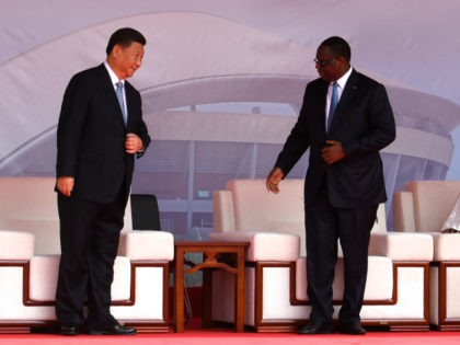 Chinese President Xi Jinping (L) and Senegalese President Macky Sall speak as they arrive for the inauguration ceremony of a wrestling arena built by a Chinese company in Dakar on July 22, 2018. - China's President Xi Jinping inked a clutch of trade accords on July 21 on the first …