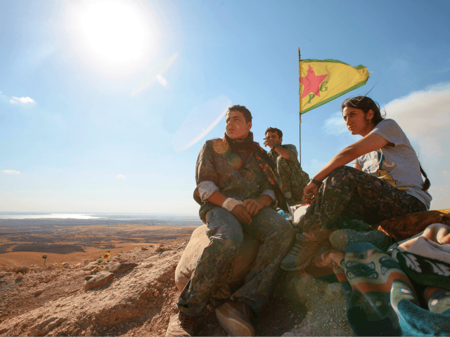 KOBANE, SYRIA - JUNE 20: (TURKEY OUT) A Kurdish People's Protection Units, or YPG fighters stand near a check point in the outskirts of the destroyed Syrian town of Kobane, also known as Ain al-Arab, Syria. June 20, 2015. Kurdish fighters with the YPG took full control of Kobane and …