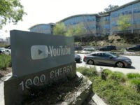A YouTube sign is shown across the street from the company's offices in San Bruno, Calif., Tuesday, April 3, 2018. A woman opened fire at YouTube headquarters Tuesday, setting off a panic among employees and wounding several people before fatally shooting herself, police and witnesses said. (AP Photo/Jeff Chiu)