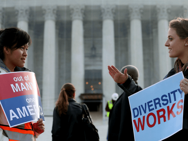 The Supreme Court Hears Hears Affirmative Action Case Regarding Admissions To Texas University WASHINGTON, DC - OCTOBER 10: Helen Tran (L) and Jennifer Hicks protest in front of the U.S. Supreme Court on October 10, 2012 in Washington, DC. Today the high court is scheduled to hear arguments on Fisher …
