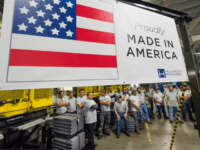 Workers at the Hollywood Bed Frame Company attend an event to mark the company's upcoming expansion which will double the manufacturer's workforce, adding 100 new local jobs, at the company's factory in Commerce, California, seven miles (11 km) southeast from downtown Los Angeles, April 14, 2017. Hollywood Bed Frame says …