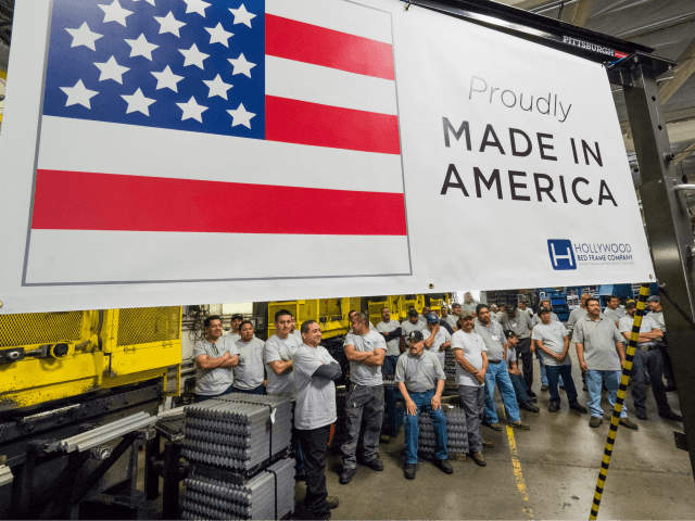 Workers at the Hollywood Bed Frame Company attend an event to mark the company's upcoming expansion which will double the manufacturer's workforce adding 100 new local jobs at the company's factory in Commerce California seven miles (11