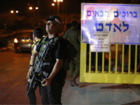 A picture taken on July 26, 2018 shows Israeli security forces at the Adam settlement in the occupied West Bank where a stabbing attack took place. - Three Israelis were wounded in a knife attack in a West Bank settlement close to Ramallah, the Israeli army said. (Photo by Ahmad …