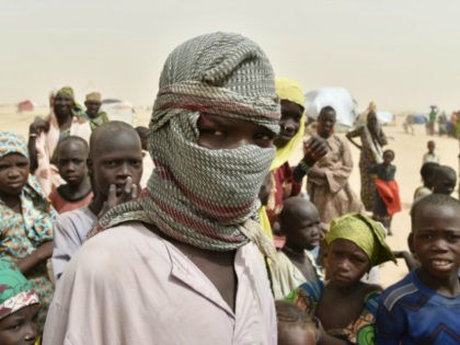 A boy looks on in a camp in the village of Kidjendi near Diffa on June 19, 2016 as displaced families fled from Boko Haram attacks in Bosso AFP/File Issouf Sanogo