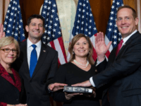 U.S. House Speaker Paul Ryan, R-Wis., administers the House oath of office to freshman lawmaker Rep. Ted Budd, R-N.C., during a mock swearing-in ceremony on Capitol Hill in Washington, Jan. 3, 2017. Budd is one of the Republicans in Congress whom national Democrats say they want to defeat in 2018. …