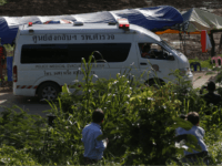 An ambulance with flashing lights leaves the cave rescue area in Mae Sai, Chiang Rai province, northern Thailand, Monday, July 9, 2018. The ambulance has left the cave complex area hours after the start of the second phase of an operation to rescue a youth soccer team trapped inside the …