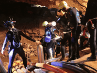 In this undated photo released by Royal Thai Navy on Saturday, July 7, 2018, Thai rescue team members walk inside a cave where 12 boys and their soccer coach have been trapped since June 23, in Mae Sai, Chiang Rai province, northern Thailand. The local governor in charge of the …