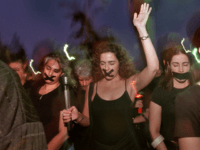 A group of protesters dressed in black with their mouths taped shut march along Miami's beach streets April 25, 2000 in Miami, FL. Several area businesses closed for the day while impromptu demonstrations erupted to protest Elian Gonzalez's removal from his Miami relative's home by federal authorities on Saturday April …