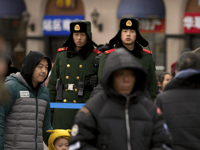 Chinese paramilitary police stand guard outside of the Beijing Railway Station in Beijing, Friday, Feb. 9, 2018. Millions of Chinese have taken to the country's rails, skies, and highways ahead of the Lunar New Year holiday next week, with the main travel rush expected to begin this weekend. (AP Photo/Mark …