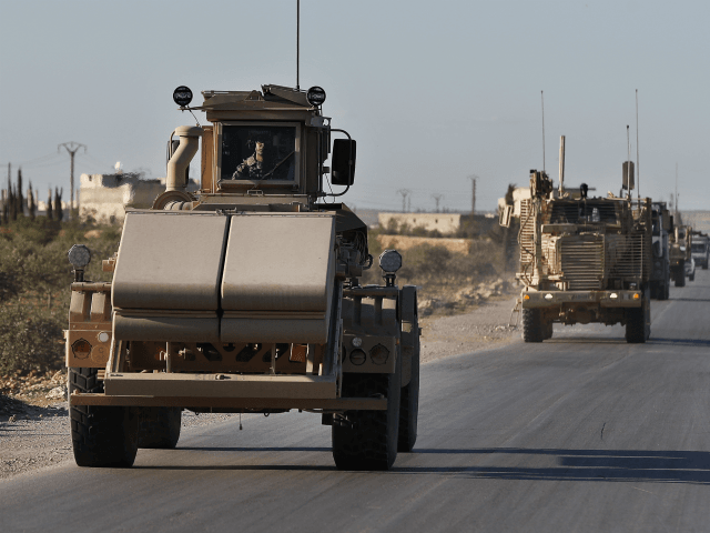 "A U.S. mine detector armored vehicle, leads a convoy of U.S. troops, on a road leading to the tense front line with Turkish-backed fighters, in Manbij town, north Syria, Saturday, March 31, 2018. President Donald Trump's unscripted public declaration this week about pulling out of Syria ""very soon"" while at …"