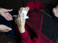Doret Kohl (L), nurse of the German Red Cross (DRK, or Deutsches Rotes Kreuz) attends to a patient in the geriatric day care facility at Villa Albrecht on March 18, 2013 in Berlin, Germany. A great number of senior Citzens struggle with various forms of dementia at Villa Albrecht. The …