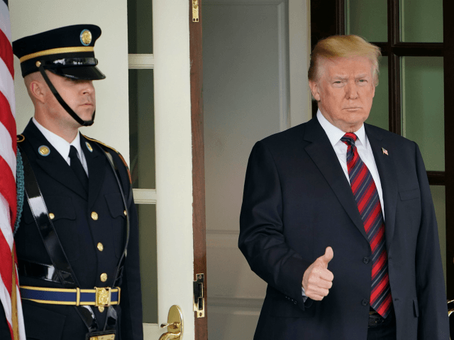 US President Donald Trump gives the thumbs-up as he awaits the arrival of South Korea's President Moon Jae-in outside of the West Wing of the White House on May 22, 2018 in Washington, DC. - Donald Trump welcomed South Korea's president to the White House Tuesday, a high stakes and …