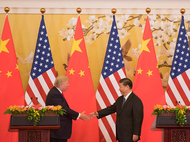 US President Donald Trump and Chinese President Xi Jinping shake hands during a joint statement in Beijing on November 9, 2017. Donald Trump and Xi Jinping put their professed friendship to the test on November 9 as the least popular US president in decades and the newly empowered Chinese leader …