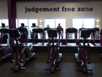 People exercise at Planet Fitness in the Columbia Mall on July 24, 2017 in Bloomsburg, Pennsylvania. Mall space is being repurposed as more department store chains close stores that have traditionally served as 'anchors' at malls. The Planet Fitness now occupies the space that was previously a Sears. The glass …