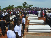 Coffins are prepared for burial during a funeral service for 17 worshippers and two priests, who were allegedly killed by Fulani herdsmen, at Ayati-Ikpayongo in Gwer East district of Benue State, north-central Nigeria on May 22, 2018. - Two Nigerian priests and 17 worshippers have been buried, nearly a month …