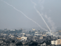 A picture taken on July 14, 2018 shows Palestinian rockets being fired from Gaza City towards Israel. - Israel's military said it had launched air strikes targeting Hamas in the Gaza Strip on July 14 as rockets and mortars were lobbed into southern Israel from the blockaded Palestinian enclave. (Photo …