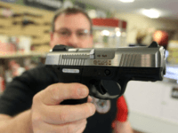 Gun retailer Steven King holds a Ruger SR40C at his Bridgeton, Missouri, shop. Wednesday, investors in Sturm, Ruger & Co. voted to have the gun-maker conduct a firearms safety report. File Photo by Bill Greenblatt/UPI