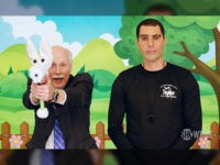 "Sacha Baron Cohen has a gun rights advocate pose with a ""gunny rabbit,"" a firearm dressed up as a toy rabbit, in the debut episode of his Showtime series ""Who Is America."""