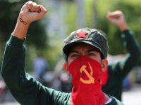 A Filipino activist uses a cloth printed with the hammer and sickle symbol to cover his face during a rally near the Malacanang presidential palace in Manila, Philippines Monday, Aug. 22, 2016. Philippine President Rodrigo Duterte recently reimposed an indefinite cease-fire after communist guerrillas declared their own truce as both …