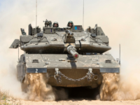 An Israeli tank rolls along the border between Israel and the Gaza Strip on May 6, 2016 as Israeli forces search for infiltration tunnels leading into southern Israel. Three days of mortar and tank fire between Israel and Palestinian militants, as well as Israeli air strikes, have raised concerns of …