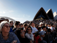 SYDNEY, AUSTRALIA - MAY 15: Large crowds line the Sydney Opera House forecourt for the arrival of teen sailor Jessica Watson following her world record attempt to become the youngest person to sail solo, non-stop and unassisted around the world, in Sydney Harbour on May 15, 2010 in Sydney, Australia. …