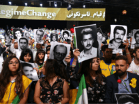 People hold pictures of relatives killed by the Mohllas regime, during 'Free Iran 2018 - the Alternative' event on June 30, 2018 in Villepinte, north of Paris during the Iranian resistance national council (CNRI) annual meeting. (Photo by Zakaria ABDELKAFI / AFP) (Photo credit should read ZAKARIA ABDELKAFI/AFP/Getty Images)