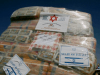 A package containing diapers stands as emergency aid supplies offered by the Israeli government needed for the recovery efforts for the victims of Hurricane Katrina, wait to be loaded into a cargo plane at Ben Gurion airport near Tel Aviv, Israel Wednesday Sept. 7, 2005. Israel is sending a search …