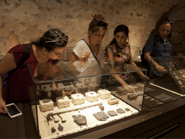 "In this Wednesday, June 27, 2018 photo, visitors look at exhibits, entitled ""The House of Herod: Life and Power in the Age of the New Testament,"" at the Terra Sancta Museum in Jerusalem. Jerusalem's Franciscan friars have opened The Terra Sancta Museum, a new museum in the old city of …"