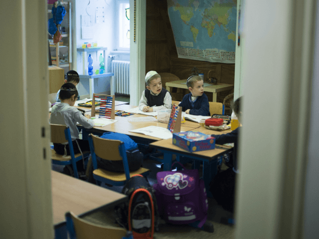 Pupils attend a math lesson during the visit of Ashkenazi Chief Rabbi of Israel at the Or Avner traditional Jewish school in Berlin, on November 8, 2013. David Lau visited the school to speak about the Kristallnacht aka Night of broken glasses, the November 1938 anti-Jewish pogrom as events get …