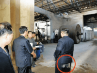 The seat of North Korean leader Kim Jong-un's pants is smudged with dust during a visit to a chemical fiber factory in Sinuiju, North Pyongan Province in this video grab from [North] Korean Central TV on Monday.