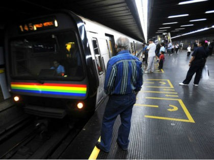 A passenger awaits to board the subway in downtown Caracas, on January 27, 2010. AFP PHOTO/Juan BARRETO (Photo credit should read JUAN BARRETO/AFP/Getty Images)
