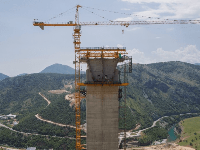 PODGORICA (Reuters) - Perched atop massive cement pillars that tower above Montenegro's picturesque Moraca river canyon, scores of Chinese workers are building a state-of-the-art highway through some of the roughest terrain in southern Europe.