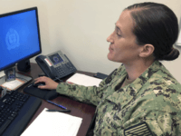 U.S. Navy Legalman First Class Tamatha Schulmerich works at her desk at the Naval War College, Wednesday, July 11, 2018, in Newport, R.I. The Navy said Tuesday it will let women sailors sport ponytails and other longer hairstyles, reversing a policy that long forbade females from letting their hair down. …