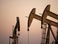 Oil rigs extract petroleum as the price of crude oil rises to nearly $120 per barrel, prompting oil companies to reopen numerous wells across the nation that were considered tapped out and unprofitable decades ago when oil sold for one-fifth the price or less, on April 25, 2008 in the …