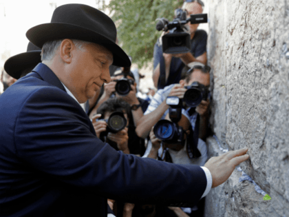 Hungarian Prime Minister Viktor Orban visits the Western Wall in Jerusalem's Old City on July 20, 2018. - The Hungarian Prime Minister pledged 'zero tolerance' for anti-Semitism on July 19, 2018, during a controversial visit to Israel after facing accusations of stoking anti-Jewish sentiment back home.Orban and Israeli Prime Minister …