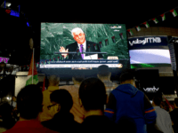 Palestinians watch a speech by Palestinian President Mahmoud Abbas at the U.N. General Assembly shown on TV in the West Bank city of Ramallah, Wednesday, Sept. 30, 2015. Abbas declared before world leaders Wednesday that he is no longer bound by agreements signed with Israel, and called on the United …