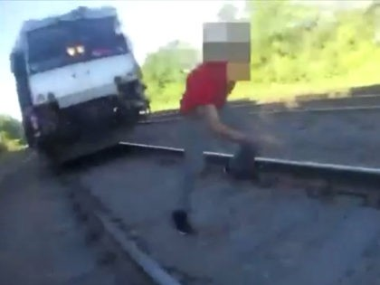 VIDEO: NJ Cop Rescues Man from Oncoming Train