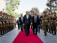 Secretary of State Mike Pompeo, center is greeted by Chief of Staff Abdul Salam Rahimi, center right, as he arrives at Gul Khanna in the Presidential Palace in Kabul, Afghanistan, Monday, July 9, 2018. Pompeo is on a trip traveling to North Korea, Japan, Vietnam, Afghanistan, Abu Dhabi, and Brussels. …