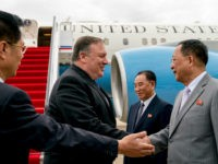 U.S. Secretary of State Mike Pompeo, second from left, is greeted by North Korean Director of the United Front Department Kim Yong Chol, center, and North Korean Foreign Minister Ri Yong Ho, second from right, as he arrives at Sunan International Airport in Pyongyang, North Korea, Friday, July 6, 2018. …