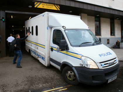 A prison van is driven out of Westminster Magistrates Court in central London on June 18, 2016. British lawmaker Jo Cox's alleged killer, Thomas Mair, ranted against 'traitors' during a brief court appearance on Saturday, as EU referendum campaigning was suspended for a third day in tribute to the slain …