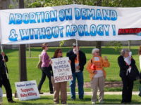 Demonstrators of both sides of the abortion debate compete for attention near the campus of Notre Dame University on May 17, 2009 in South Bend, Indiana. Activists from around the country have gathered in South Bend to protest or defend the university's decision to invite President Barack Obama, who supports …