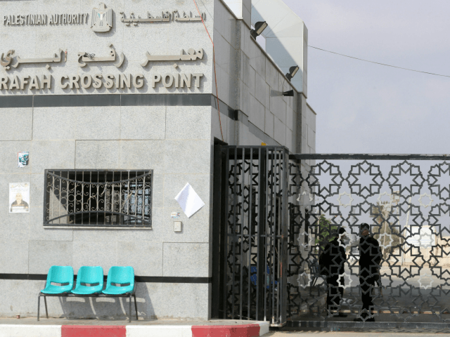 Palestinian security forces loyal to the Palestinian Authority stand at the Rafah border crossing with Egypt in the southern Gaza Strip on July 17, 2018. - Israel further tightened its blockade of the Gaza Strip preventing fuel deliveries through its only goods crossing with the Palestinian enclave after scores of …