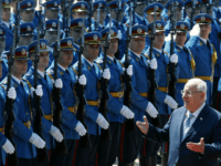 Israeli President Reuven Rivlin reviews the honour guard upon his arrival at the Serbia Palace to meet with his Serbian counterpart Aleksandar Vucic in Belgrade, Serbia, Thursday, July 26, 2018. Rivlin is on a one-day official visit to Serbia. (AP Photo/Darko Vojinovic)