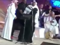 RIYADH, Saudi Arabia — A woman may face charges under a new harassment law in Saudi Arabia after storming a stage to hug a pop star, authorities and local media said Sunday.