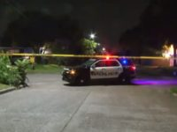 Houston police say a home invasion suspect held a woman at gunpoint and was then shot in the head by the woman's husband.