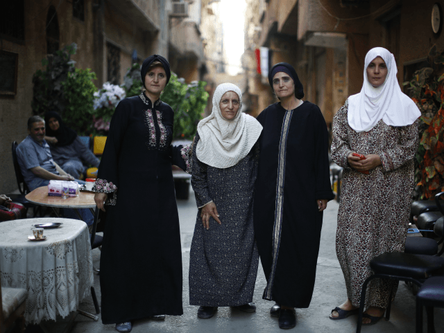 In this Monday, July 16, 2018 photo, Palestinian Abdul-Mahmoud sisters from right to left, Amal, Hanan, Izdihar, Myasar, pose for a picture outside their house on Lod street at the Palestinian refugee camp of Yarmouk in the Syrian capital Damascus, Syria. The four sisters spent Syria's seven-year conflict in the …