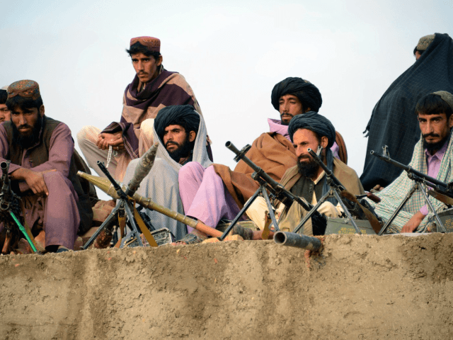 In this photograph taken on November 3, 2015, Afghan Taliban fighters listen to Mullah Mohammad Rasool Akhund (unseen), the newly appointed leader of a breakaway faction of the Taliban, at Bakwah in the western province of Farah. A breakaway faction of the Taliban has appointed its own leader in the …